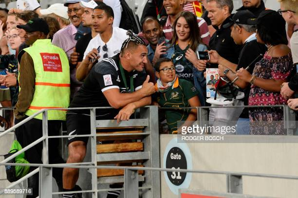 New Zealand's Teddy Stanaway poses for fans after winning the World Rugby Sevens Series at Cape Town Stadium on December 10 2017 in Cape Town / AFP...