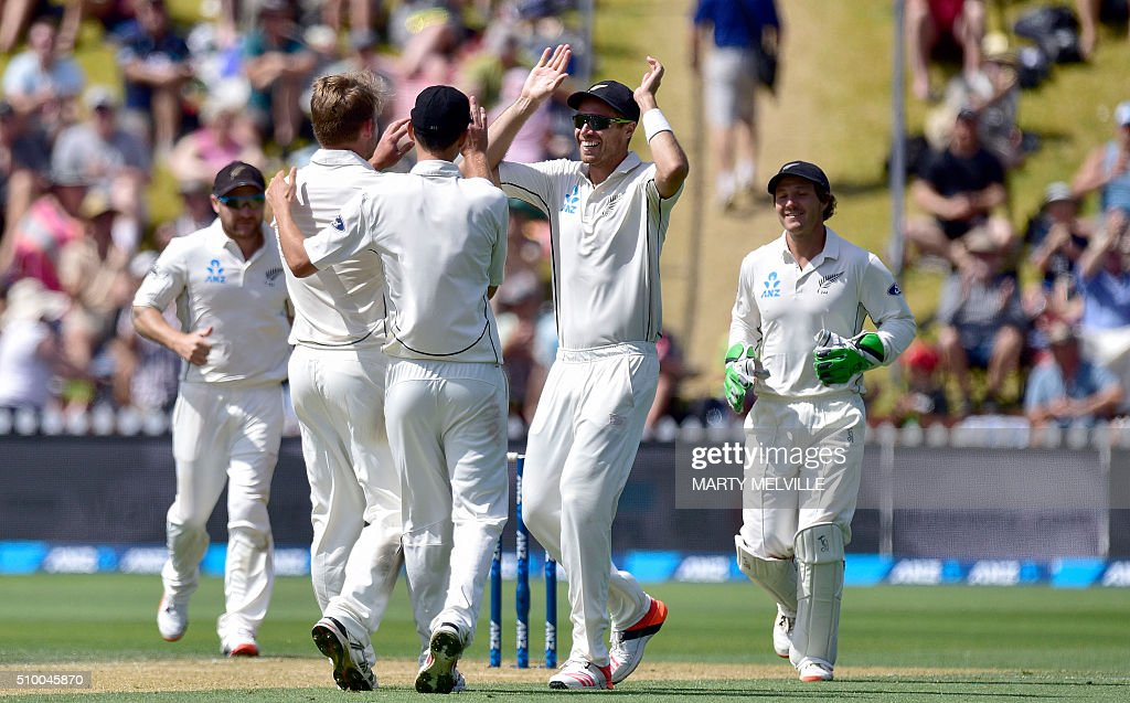 New Zealand's Tim South (Centre R) with team mates celebrate Nathan Lyon of Australia being caught during day three of the first cricket Test match between New Zealand and Australia at the Basin Reserve in Wellington on February 14, 2016. / AFP / Marty Melville