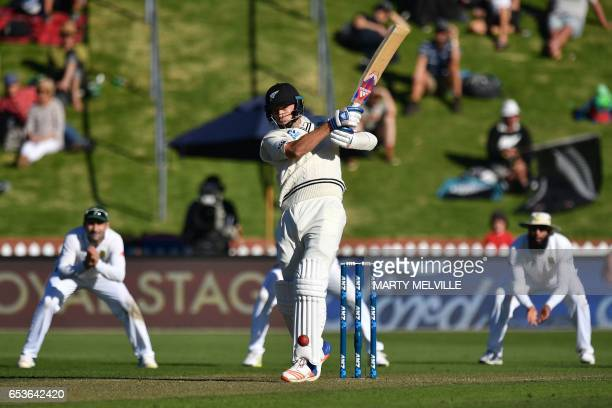 New Zealand's Tim Southee bats watched by South Africa's Hashim Amla and Dean Elgar during the second Test cricket match between New Zealand and...