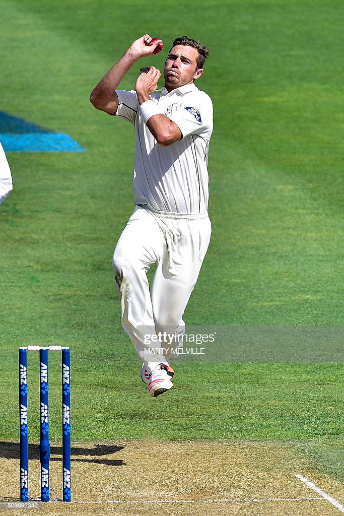 New Zealand's Tim Southee bowls during day two of the first cricket Test match between New Zealand and Australia at the Basin Reserve in Wellington on February 13, 2016. AFP PHOTO / MARTY MELVILLE / AFP / Marty Melville