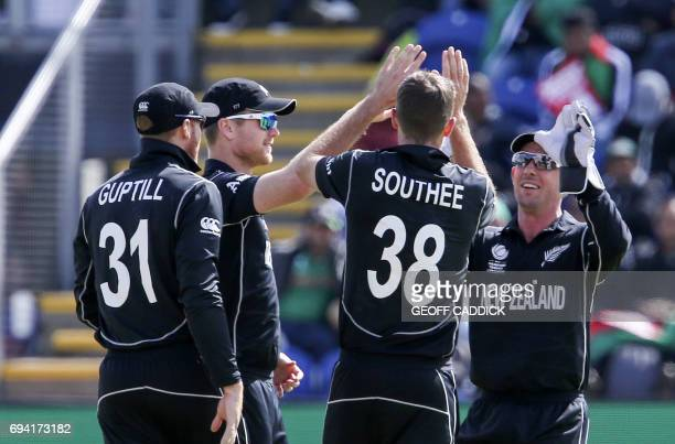 New Zealand's Tim Southee celebrates with teammates after taking the wicket of Bangladesh's Soumya Sarkar during the ICC Champions Trophy match...