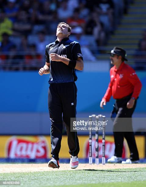 New Zealand's Tim Southee reacts after bowling during the Pool A 2015 Cricket World Cup match between New Zealand and Australia at Eden Park in...