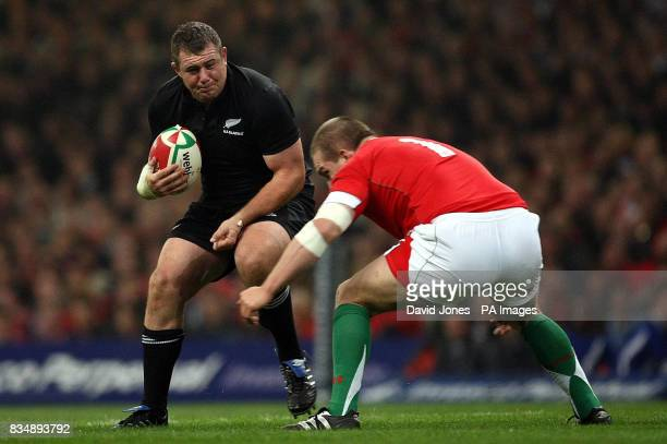 New Zealand's Tony Woodcock is tackled by Wales' Gethin Jenkins during the Invesco Perpetual Series match at the Millennium Stadium Cardiff