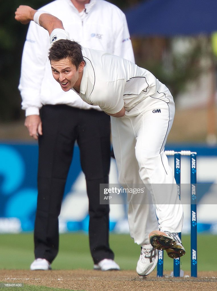 New Zealand's Trent Boult bowls during day four of the first international cricket test match between New Zealand and England played at the University Oval park in Dunedin on March 10, 2013. AFP PHOTO / Marty MELVILLE