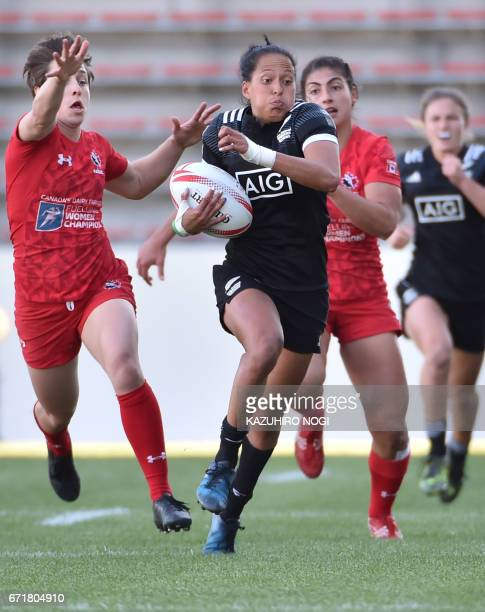 New Zealand's Tyla NathanWong runs with ball past Canadian players duirng the final at the World Rugby Women's Sevens Series in Kitakyushu Fukuoka...
