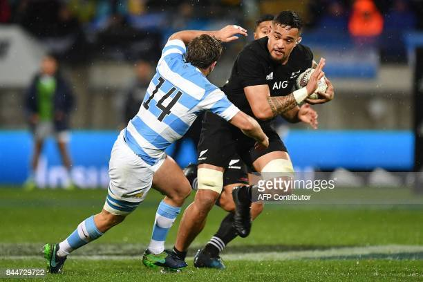New Zealand's Vaea Fifita is tackled by Argentina's Santiago Cordero during the Rugby Championship match between the New Zealand All Blacks and...