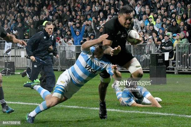 New Zealand's Vaea Fifita runs in a try as he is tackled by Argentina's Santiago Cordero during the Rugby Championship match between the New Zealand...