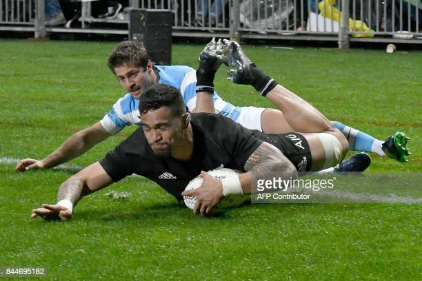 New Zealand's Vaea Fifita scores a try in front of Argentina's Santiago Cordero during the Rugby Championship match between the New Zealand All...