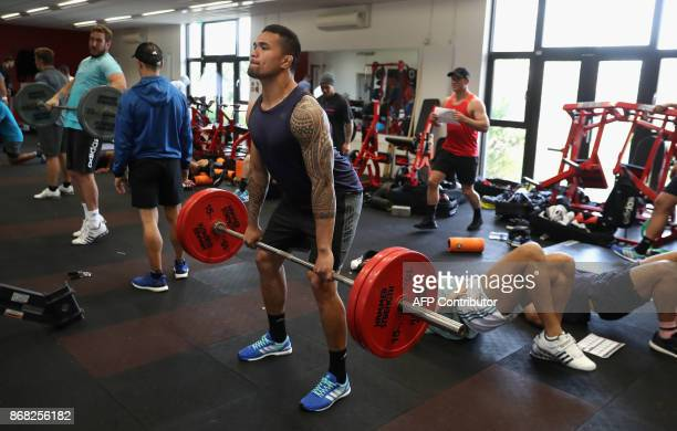 New Zealand's Vaea Fifita takes part in an All Blacks team training session in the gym at the Lensbury Hotel in Teddington southwest London on...