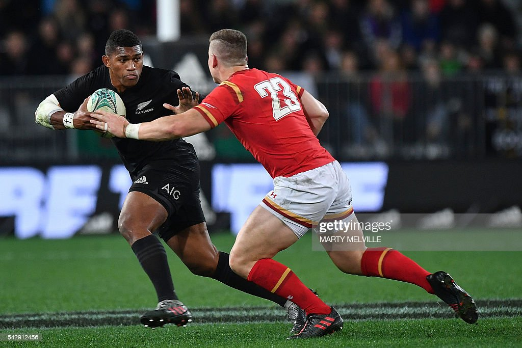 New Zealand's Waisake Noholo (L) fends off Scott Williams of Wales (R) during the third rugby union Test match between the New Zealand All Blacks and Wales at Forsyth Barr Stadium in Dunedin on June 25, 2016. / AFP / Marty Melville