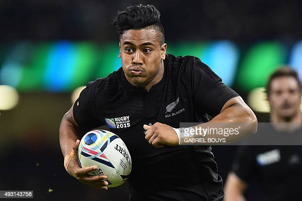 New Zealand's wing Julian Savea runs to score a try during a quarter final match of the 2015 Rugby World Cup between New Zealand and France at the...