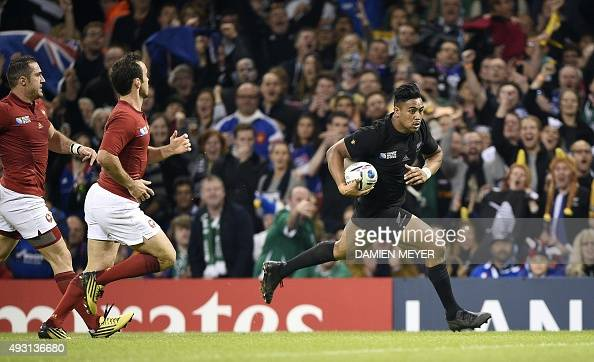 New Zealand's wing Julian Savea runs to score his team's third try during a quarter final match of the 2015 Rugby World Cup between New Zealand and...