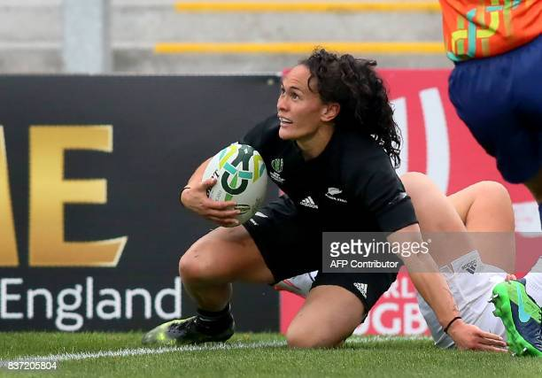 New Zealand's wing Portia Woodman scores a try during the Women's Rugby World Cup 2017 semifinal match between New Zealand and USA at The Kingspan...