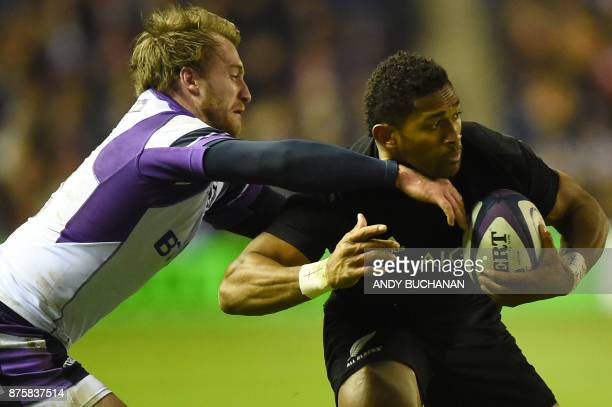 New Zealand's wing Waisake Naholo is tackled during the international rugby union test match between Scotland and New Zealand at Murrayfield stadium...