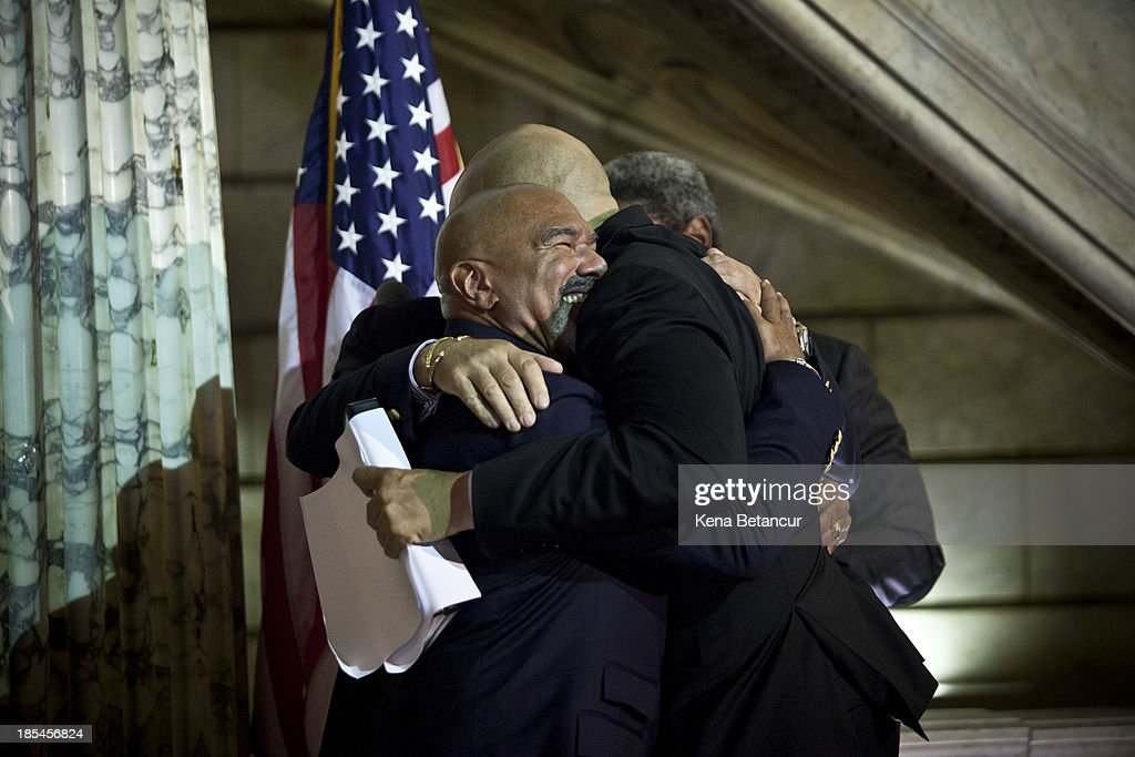 Newark Mayor and newly elected U.S. Senator <a gi-track='captionPersonalityLinkClicked' href=/galleries/search?phrase=Cory+Booker&family=editorial&specificpeople=638070 ng-click='$event.stopPropagation()'>Cory Booker</a> (C) embraces Joesph Panessidi and Orville Bell after officiating their wedding ceremony at City Hall in the early morning hours of October 21, 2013 in Newark, New Jersey. Same-sex couples were allowed to legally wed at 12:01 am on Monday across New Jersey, making the state the 14th to allow same-sex marriages. Following Friday's ruling by the New Jersey Supreme Court, Mayor Cory A. Booker will marry seven gay, lesbian, and straight couples at City Hall in Newark on Monday morning.