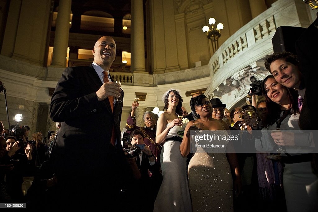 Newark Mayor and newly elected U.S. Senator <a gi-track='captionPersonalityLinkClicked' href=/galleries/search?phrase=Cory+Booker&family=editorial&specificpeople=638070 ng-click='$event.stopPropagation()'>Cory Booker</a> (L) makes a toast after officiating wedding ceremonies at City Hall in the early morning hours of October 21, 2013 in Newark, New Jersey. Same-sex couples were allowed to legally wed at 12:01 am on Monday across New Jersey, making the state the 14th to allow same-sex marriages. Following Friday's ruling by the New Jersey Supreme Court, Mayor Cory A. Booker will marry seven gay, lesbian, and straight couples at City Hall in Newark on Monday morning.