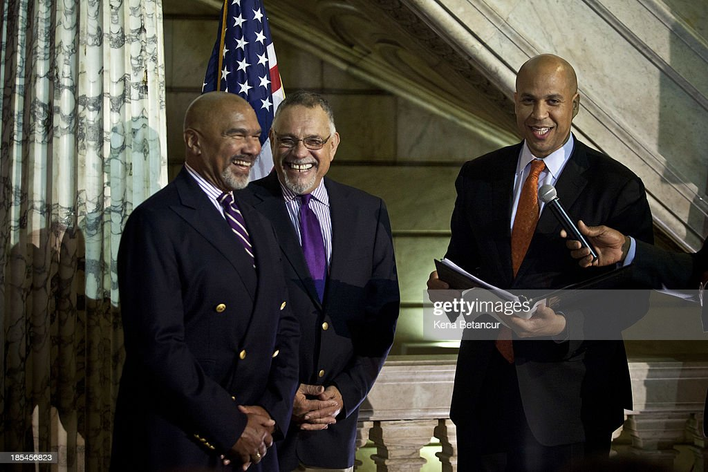 Newark Mayor and newly elected U.S. Senator <a gi-track='captionPersonalityLinkClicked' href=/galleries/search?phrase=Cory+Booker&family=editorial&specificpeople=638070 ng-click='$event.stopPropagation()'>Cory Booker</a> (L) officiates a wedding ceremony for Joesph Panessidi, 65, (C) and Orville Bell, 65, at City Hall in the early morning hours of October 21, 2013 in Newark, New Jersey. Same-sex couples were allowed to legally wed at 12:01 am on Monday across New Jersey, making the state the 14th to allow same-sex marriages. Following Friday's ruling by the New Jersey Supreme Court, Mayor Cory A. Booker will marry seven gay, lesbian, and straight couples at City Hall in Newark on Monday morning.