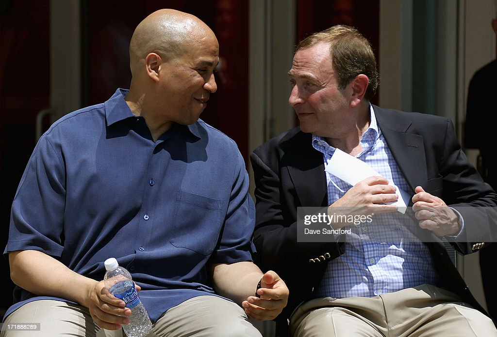 Newark mayor <a gi-track='captionPersonalityLinkClicked' href=/galleries/search?phrase=Cory+Booker&family=editorial&specificpeople=638070 ng-click='$event.stopPropagation()'>Cory Booker</a> chats with NHL commissioner <a gi-track='captionPersonalityLinkClicked' href=/galleries/search?phrase=Gary+Bettman&family=editorial&specificpeople=215089 ng-click='$event.stopPropagation()'>Gary Bettman</a> during the New Jersey Legacy Tree Project Press Conference at Prudential Center on June 29, 2013 in Newark, New Jersey. As part of the NHL's commitment to support the local environment of host cities for NHL events through its NHL Green initiative, the NHL Foundation has donated 30 trees to the Devils Care Foundation.