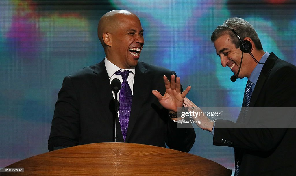 Newark Mayor <a gi-track='captionPersonalityLinkClicked' href=/galleries/search?phrase=Cory+Booker&family=editorial&specificpeople=638070 ng-click='$event.stopPropagation()'>Cory Booker</a> laughs at the podium with stage manager David Cove (R) during a walkthrough before the start of day one of the Democratic National Convention at Time Warner Cable Arena on September 4, 2012 in Charlotte, North Carolina. The DNC that will run through September 7, will nominate U.S. President Barack Obama as the Democratic presidential candidate.