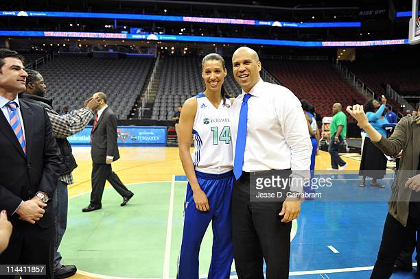 Newark Mayor Cory Booker poses with Nicole Powell of the New York Liberty during a 'Welcome the Liberty to Newark' event on May 19 2011 at the...