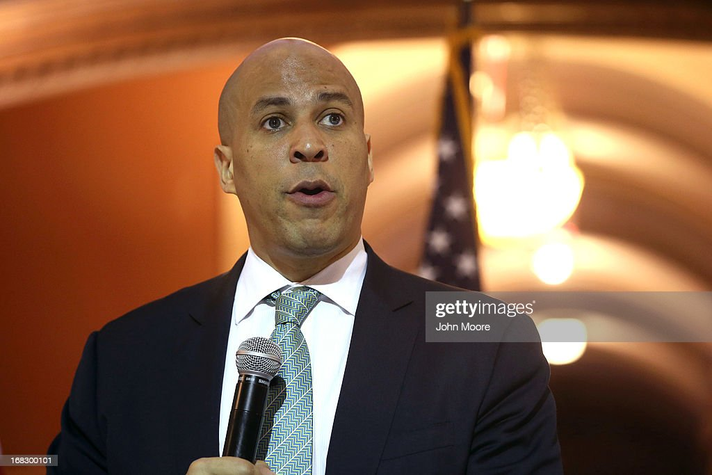 Newark Mayor <a gi-track='captionPersonalityLinkClicked' href=/galleries/search?phrase=Cory+Booker&family=editorial&specificpeople=638070 ng-click='$event.stopPropagation()'>Cory Booker</a> speaks at the Newark City Hall on May 8, 2013 in Newark, New Jersey. Booker, who has declared that he will run for New Jersey's open U.S. Senate seat in 2014, was attending a ceremony honoring 90-year-old WWII veteran Willie Wilkins on the 68th anniversary of Victory in Europe Day.