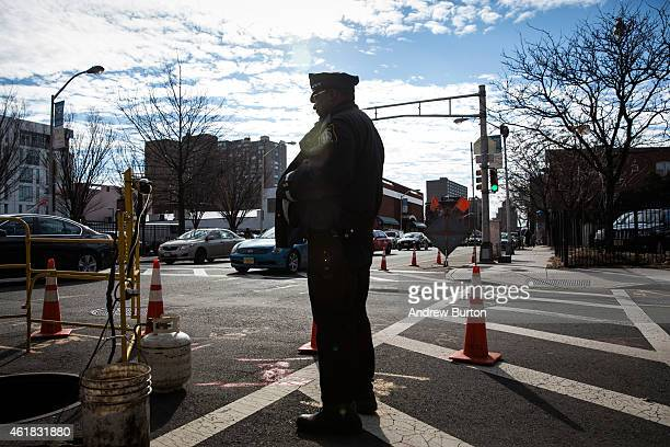 A Newark New Jersey police officer patrols a corner on January 20 2015 in Newark New Jersey The city government is establishing a Civilian Complaint...