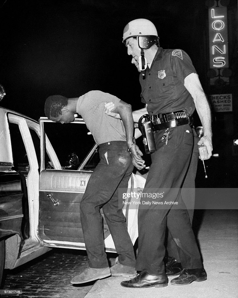 Newark Police arrest a looter at Springfield Ave and Mercer St during riots