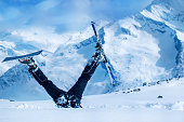 Newbie skier stuck  in deep snow with his legs upside down