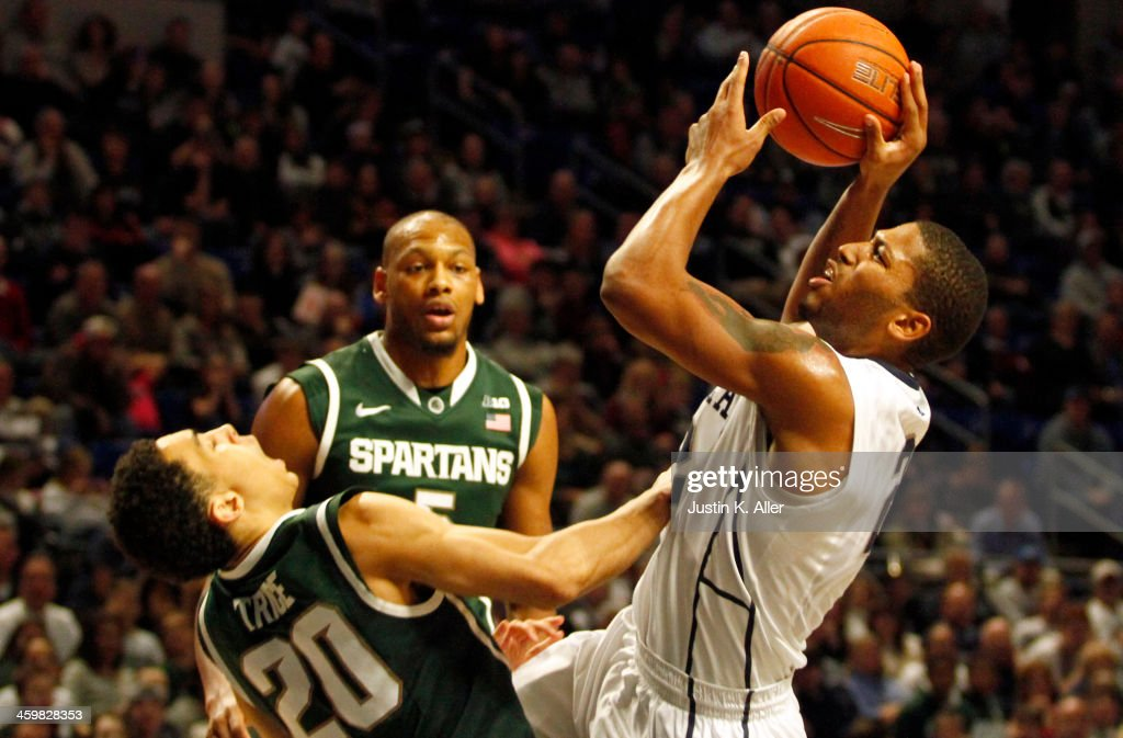 D.J. Newbill #2 of the Penn State Nittany Lions drives to the basket against Travis Trice #20 of the Michigan State Spartans at the Bryce Jordan Center on December 31, 2013 in State College, Pennsylvania.