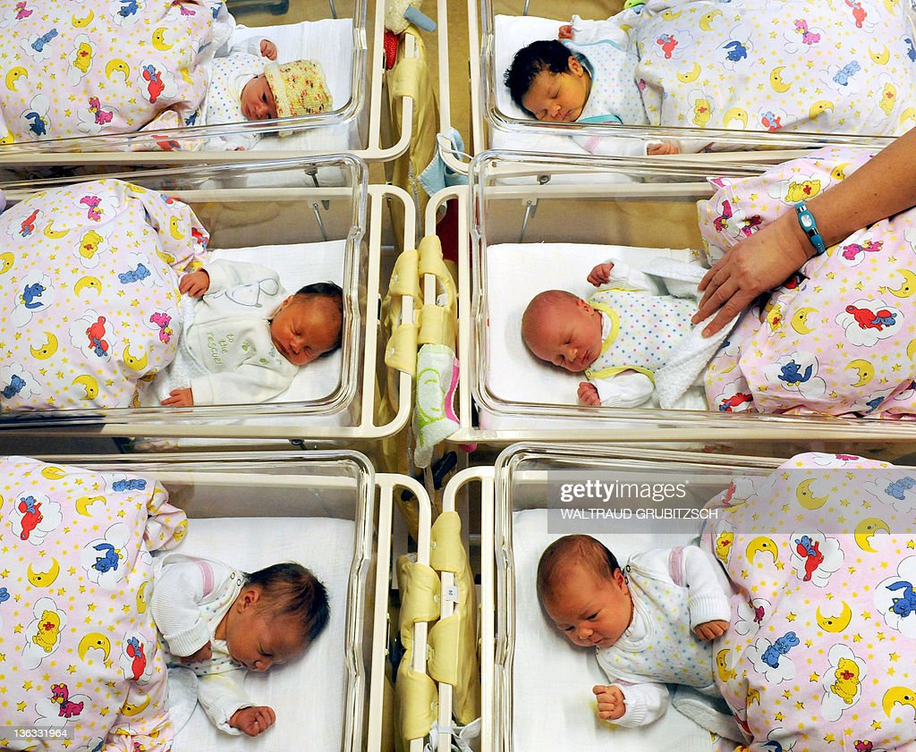 Newborn babies lay in their beds at the St. Elisabeth and St. Barbara hospital in Halle, eastern Germany, on January 2, 2012. In the year 2011, 1863 babies were born at the hospital. AFP PHOTO / WALTRAUD GRUBITZSCH GERMANY OUT