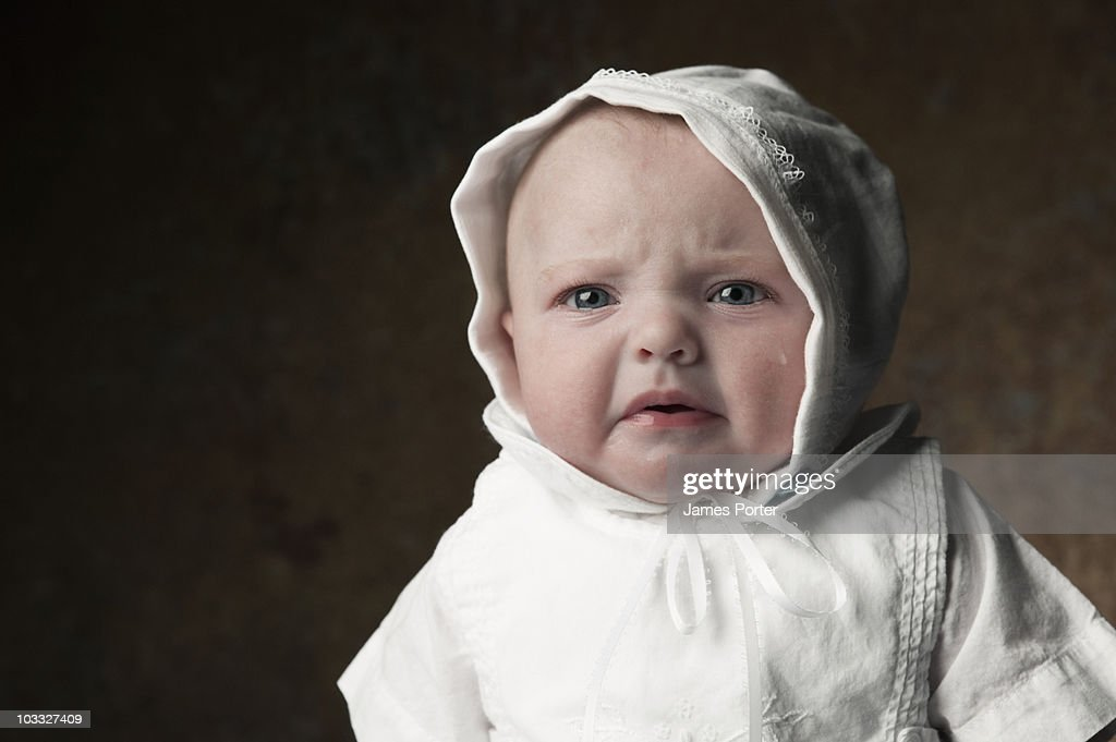 Newborn Baby Dressed in Baptismal Gown : Stock Photo