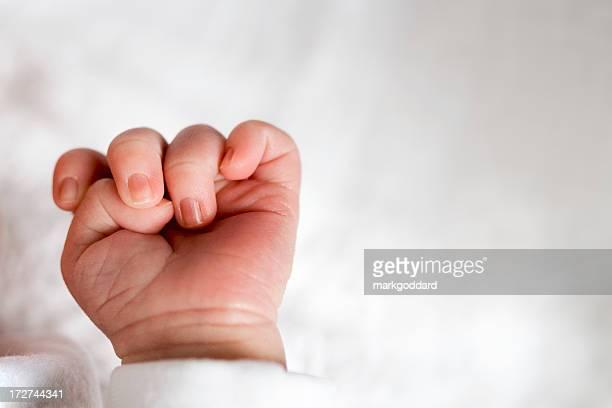 Newborn baby fingers curled inward
