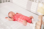 Newborn baby girl sleep first days of life. Cute little newborn child sleeping peacefully