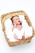 Newborn Baby In Basket