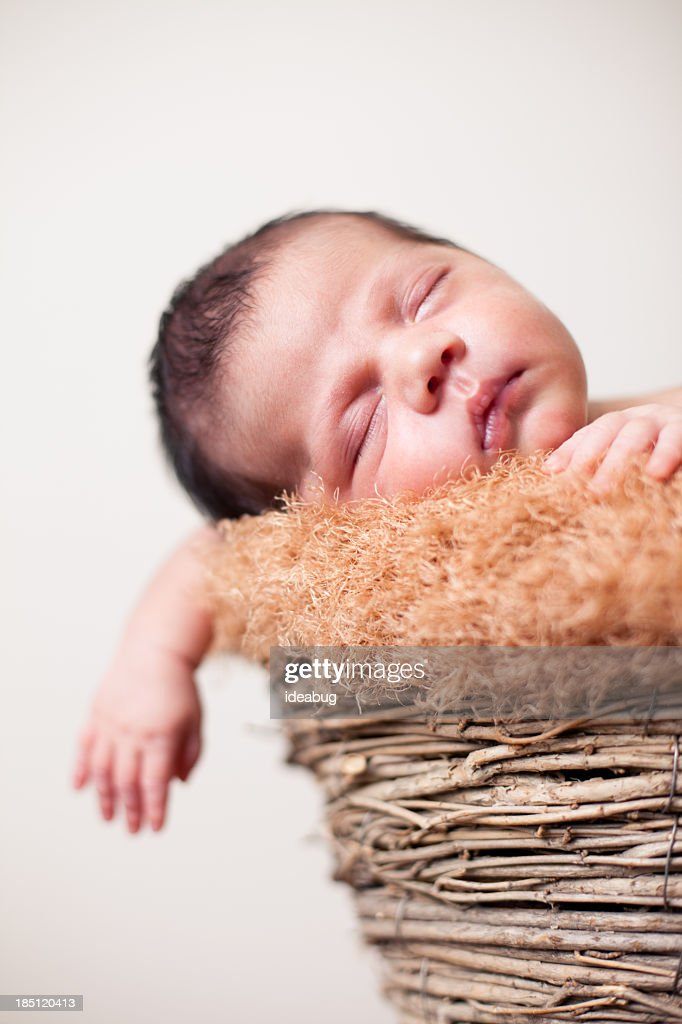 Newborn Baby Sleeping Peacefully in Basket with Fuzzy Texture Bl : Stock Photo