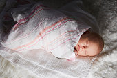 Newborn baby swaddled in blanket