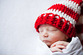 Newborn Baby Wearing Christmas Hat