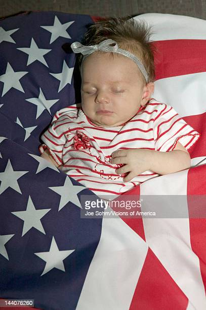 Newborn baby wrapped in American flag was born on October 16th the birthday of the 300 Millionth American Ventura California