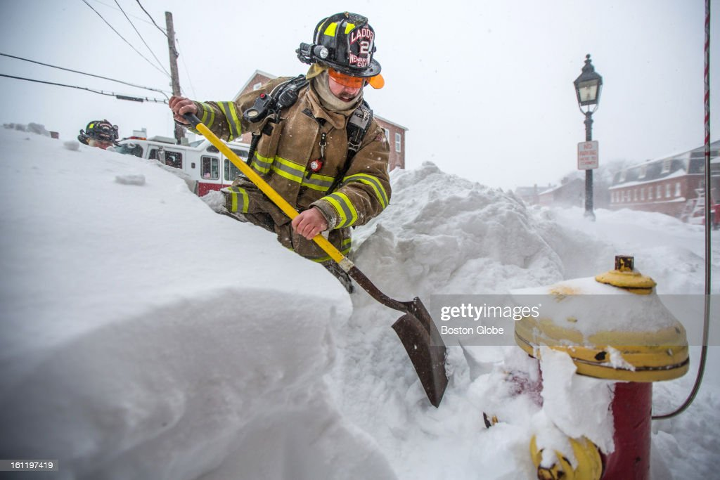 Newburyport Firefighter George Fraley worked to clear snow from fire hydrants in Newburyport as a large winter storm hit the region.