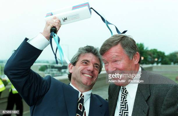 Newcastle boss Kevin Keegan cracks his Premiership rival Manchester United manager Alex Ferguson over the head with a football rattle at Wembley as...