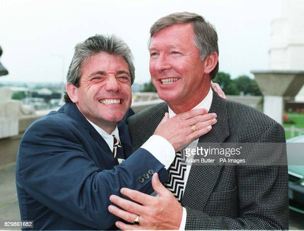Newcastle boss Kevin Keegan gets to grips with Manchester United manager Alex Ferguson as they meet at Wembley for the start of the European...