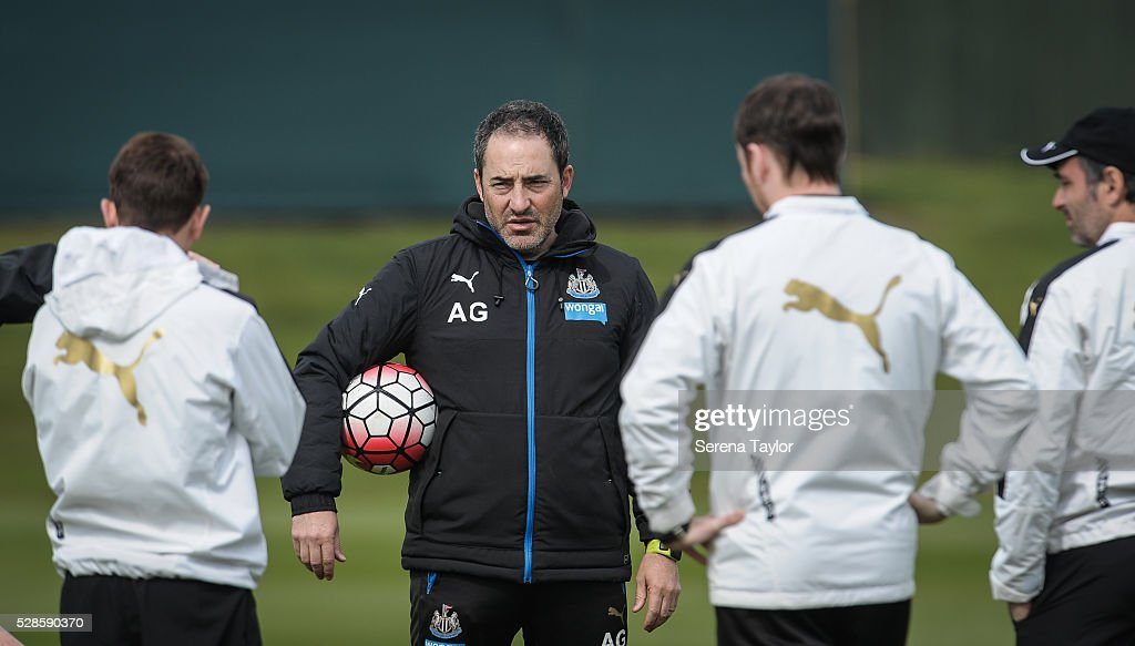Newcastle Coach Antonio Gomez Perez (C) holds a ball under his arm during the Newcastle United Training session at The Newcastle United Training Centre on May 6, 2016, in Newcastle upon Tyne, England.