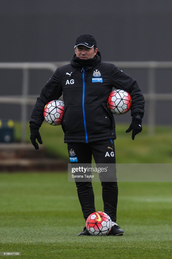 Newcastle Coach Antonio Gomez Perez holds a training ball under each arm and at his feet during the Newcastle United Training session at The Newcastle United Training Centre on April 1, 2016, in Newcastle upon Tyne, England.