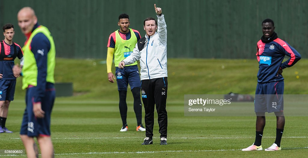 Newcastle Coach Ian Cathro (C) shouts instructions during the Newcastle United Training session at The Newcastle United Training Centre on May 6, 2016, in Newcastle upon Tyne, England.