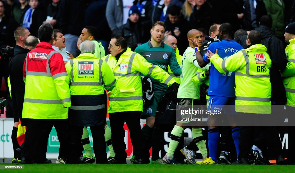 Newcastle coach John Carver (left, white top) is involved in an incident at half time of the Barclays Premier League match between Wigan Athletic and Newcastle United at DW Stadium on March 17, 2013 in Wigan, England.