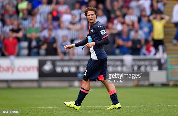 Newcastle defender Daryl Janmaat leaves the field after being sent off during the Barclays Premier League match between Swansea City and Newcastle...
