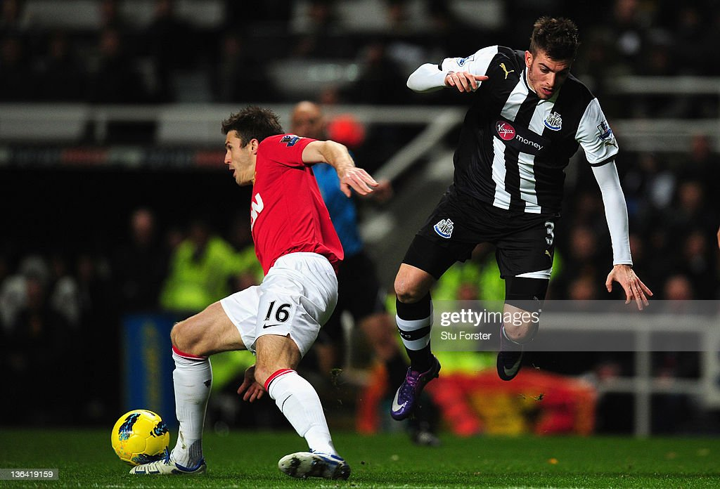 Newcastle defender <a gi-track='captionPersonalityLinkClicked' href=/galleries/search?phrase=Davide+Santon&family=editorial&specificpeople=5679382 ng-click='$event.stopPropagation()'>Davide Santon</a> is tackled by <a gi-track='captionPersonalityLinkClicked' href=/galleries/search?phrase=Michael+Carrick&family=editorial&specificpeople=214599 ng-click='$event.stopPropagation()'>Michael Carrick</a> during the Barclays Premier league game between Newcastle United and Manchester United at St James' Park on January 4, 2012 in Newcastle upon Tyne, England.