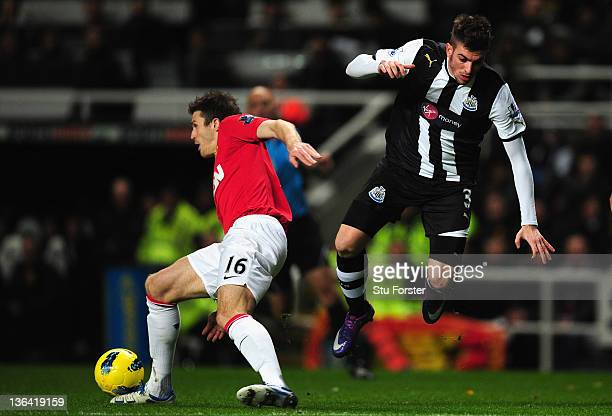 Newcastle defender Davide Santon is tackled by Michael Carrick during the Barclays Premier league game between Newcastle United and Manchester United...