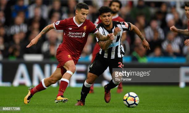 Newcastle defender DeAndre Yedlin challenges Phillipe Coutinho of Liverpool during the Premier League match between Newcastle United and Liverpool at...