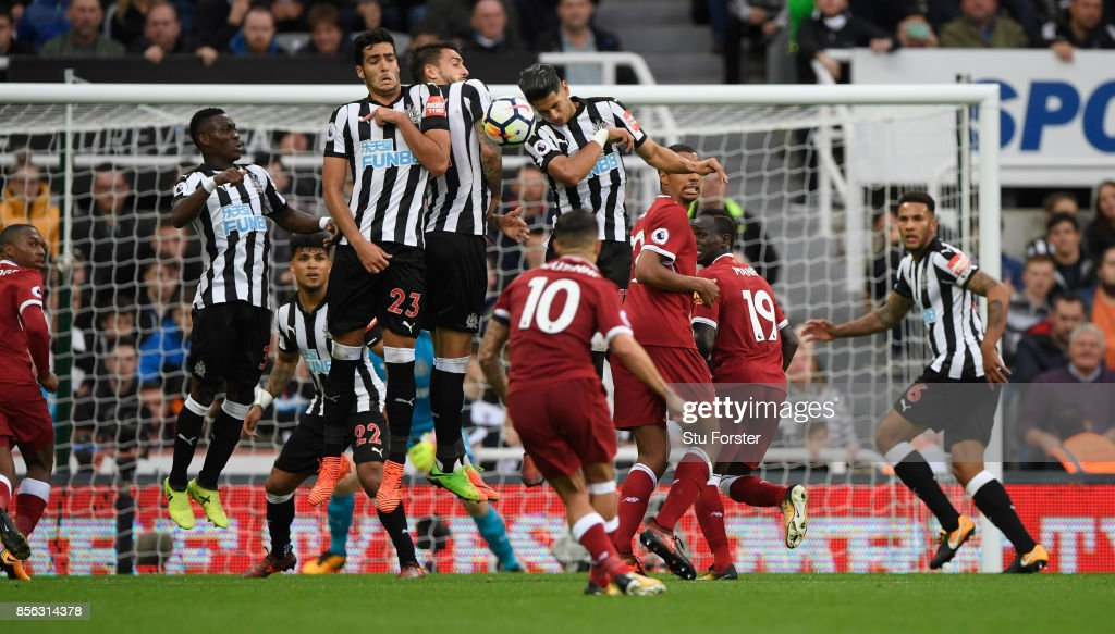 Newcastle defenders defend a free kick by Phillipe Coutinho of Liverpool during the Premier League match between Newcastle United and Liverpool at St. James Park on October 1, 2017 in Newcastle upon Tyne, England.